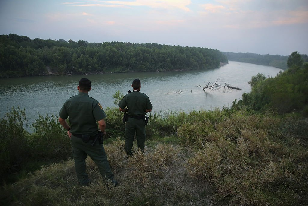 MISSION, TX - JULY 24: U.S. Border Patrol agents look for immigrants crossing the Rio Grande from Mexico (L), to the United States at dusk on July 24, 2014 near Mission, Texas. Tens of thousands of undocumented immigrants, many of them families or unaccompanied minors, have crossed illegally into the United States this year and presented themselves to federal agents, causing a humanitarian crisis on the U.S.-Mexico border. Texas' Rio Grande Valley has become the epicenter of the latest immigrant crisis, as more immigrants, especially Central Americans, cross illegally from Mexico into that sector than any other stretch of the America's 1,933 mile border with Mexico. (Photo by John Moore/Getty Images)