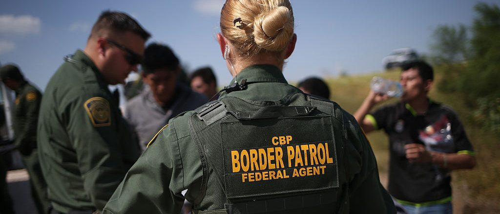 MCALLEN, TX - AUGUST 07:  U.S. Border Patrol agents detain undocumented immigrants after they crossed the border from Mexico into the United States on August 7, 2015 in McAllen, Texas.   (Photo by John Moore/Getty Images)