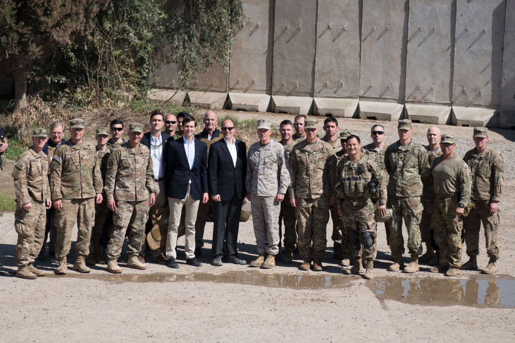 QAYYARAH WEST, IRAQ - APRIL 04: In this handout provided by the Department of Defense (DoD), Jared Kushner, Senior Advisor to President Donald J. Trump, poses for a photograph with military officials and service members at a forward operating base near Qayyarah West in Iraq, April 4, 2017. (Photo by Dominique A. Pineiro/DoD via Getty Images)