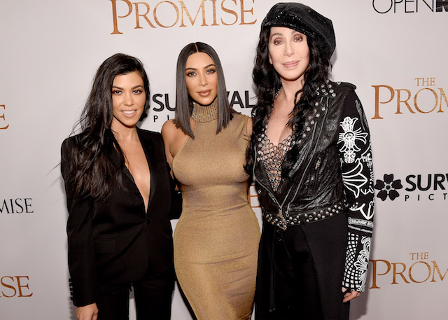 "HOLLYWOOD, CA - APRIL 12: TV personalities Kourtney Kardashian, Kim Kardashian West, and actor/singer Cher attend the premiere of Open Road Films' ""The Promise"" at TCL Chinese Theatre on April 12, 2017 in Hollywood, California. (Photo by Kevork Djansezian/Getty Images)"