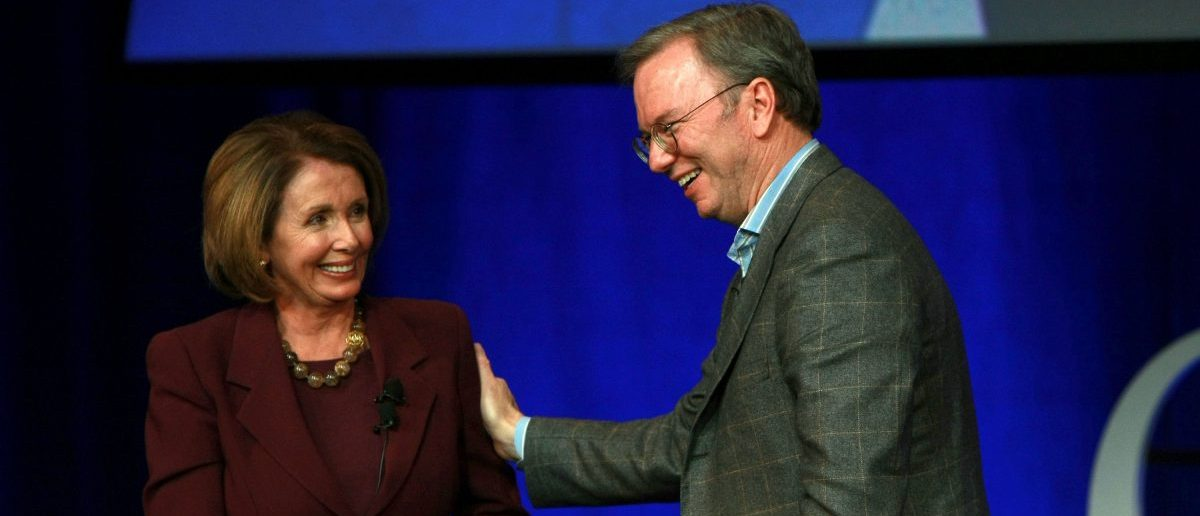 MOUNTAIN VIEW, CA - OCTOBER 27:  U.S. Speaker of the House Nancy Pelosi (L) and Google CEO Eric Schmidt stand on stage at the end of a conversation for Google employees October 27, 2008 at Google headquarters in Mountain View, California. Pelosi and Schmidt engaged in a conversation and answered questions as part of the Google speaker series.  (Photo by Justin Sullivan/Getty Images)