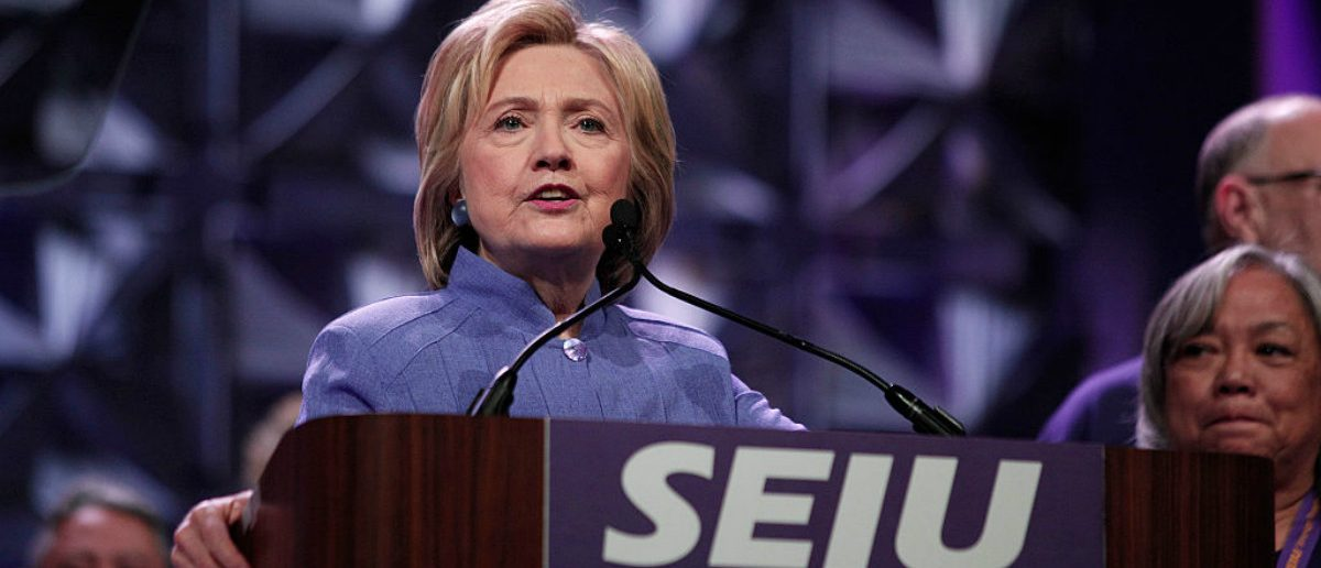 Democratic presidential candidate Hillary Clinton speaks at the Service Employees International Union (SEIU) 2016 International Convention at Cobo Center May 23, 2016 in Detroit, Michigan. Recent polls show Clinton in a tight race with Republican candidate Donald Trump. (Photo by Bill Pugliano/Getty Images)