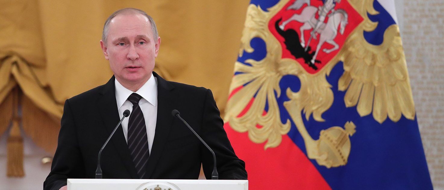 Russian President Vladimir Putin delivers a speech during a reception dedicated to the celebration of the New Year at the Kremlin in Moscow on December 28, 2016. (PHOTO: MICHAEL KLIMENTYEV/AFP/Getty Images)