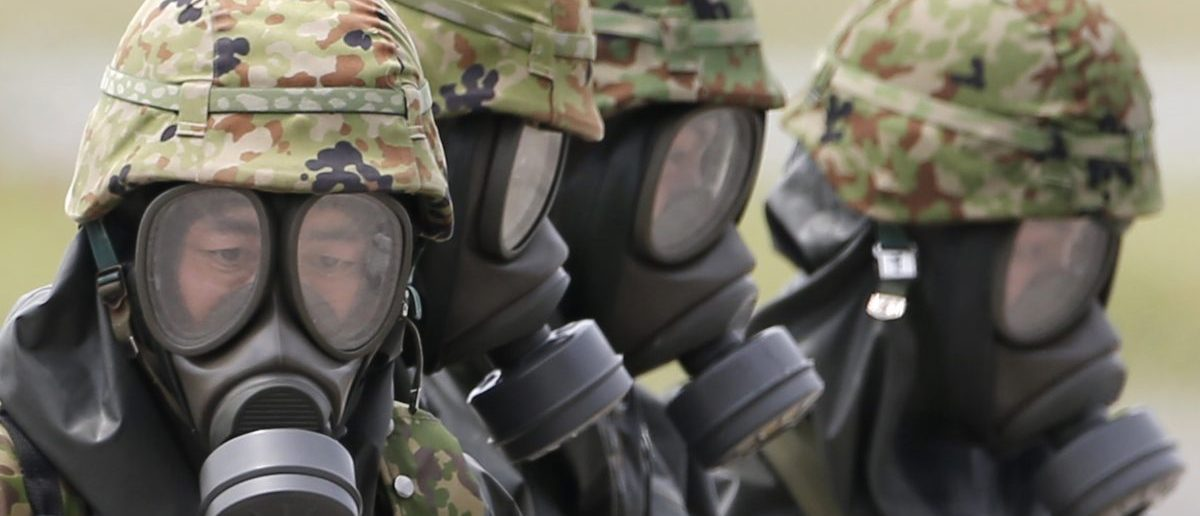 Personnel from Japan's Self-Defense Forces in protective gear take part in a nuclear, biological and chemical weapons (NBC) exercise. REUTERS/Issei Kato
