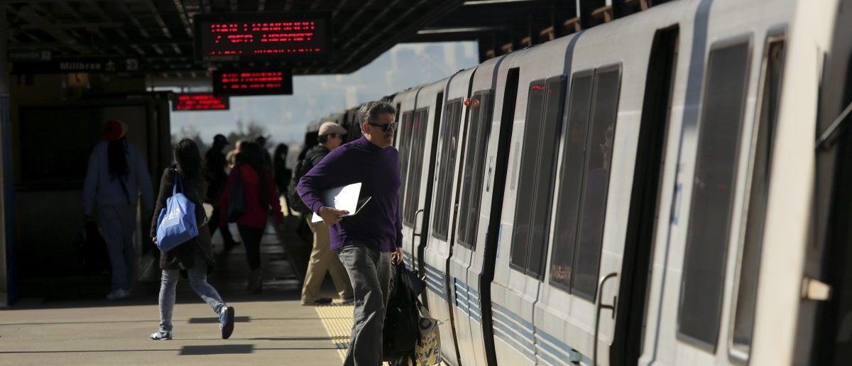Passengers board a Bay Area Rapid Transit (BART) train at the Rockridge station in Oakland, California February 12, 2015. Tens of thousands of commuters on San Francisco's Bay Area Rapid Transit system may have been exposed to measles after an infectious Bay Area resident rode a train to and from work for three days last week, public health officials said on Wednesday. [REUTERS/Robert Galbraith]