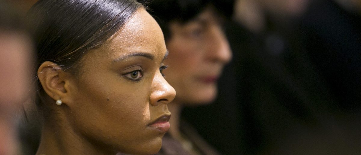 Shayanna Jenkins, fiancee of former NFL player Aaron Hernandez, listens during the murder trial for Hernandez at the Bristol County Superior Court in Fall River, Massachusetts, April 15, 2015. REUTERS/Dominick Reuter