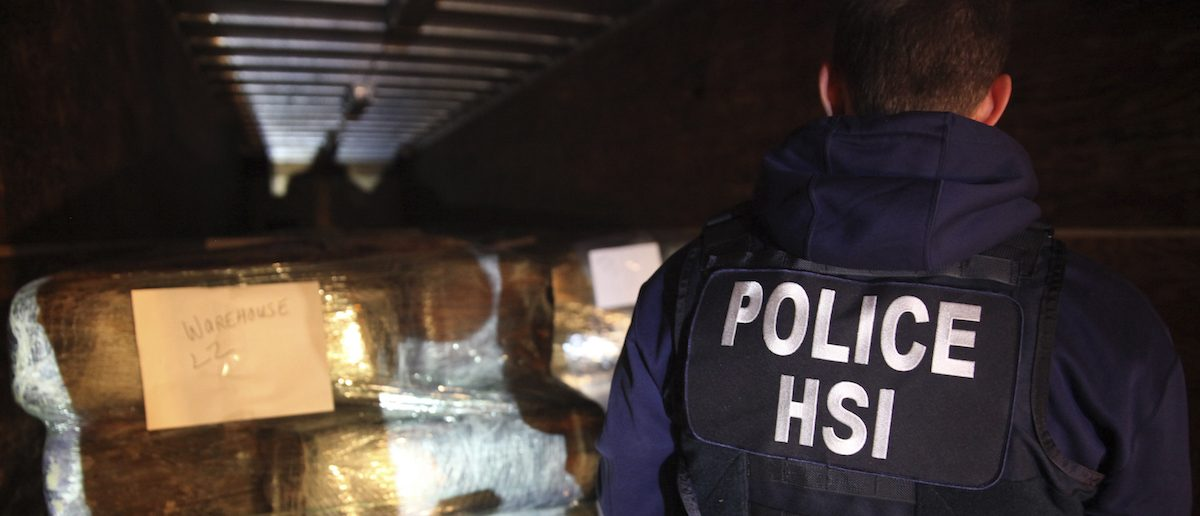 A Homeland Security special agent examines seized drugs in a highly sophisticated tunnel used to smuggle drugs between the U.S. and Mexico. (REUTERS/ICE/Handout via Reuters)