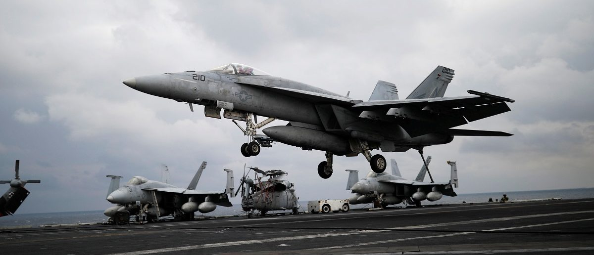 """A U.S. F18 fighter jet lands on the deck of U.S. aircraft carrier USS Carl Vinson during an annual joint military exercise called """"Foal Eagle"""" between South Korea and U.S., in the East Sea, South Korea, March 14, 2017. REUTERS/Kim Hong-Ji"""
