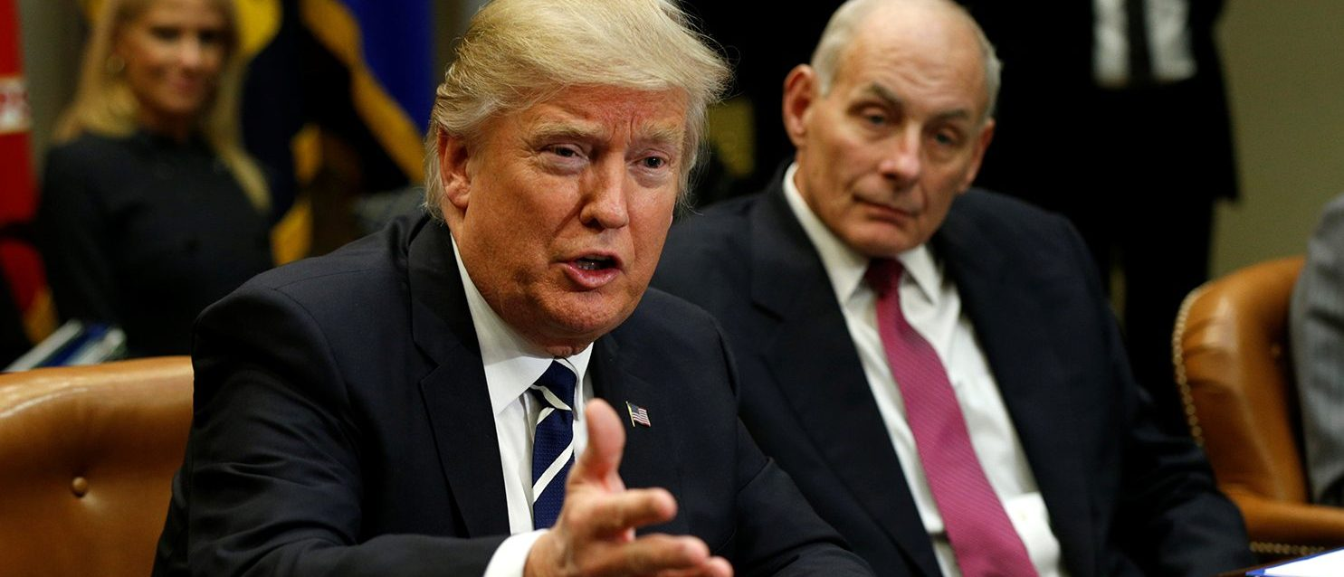 Homeland Security Secretary John Kelly (R) listens to U.S. President Donald Trump during a meeting with cyber security experts in the Roosevelt Room of the White House in Washington January 31, 2017. (PHOTO: REUTERS/Kevin Lamarque)