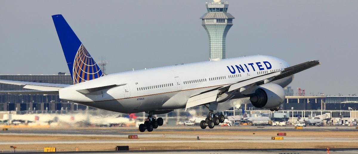 United Airlines Boeing 777 passenger jet airplane arriving for a landing at O'Hare International Airport in Chicago, Illinois (Shutterstock)