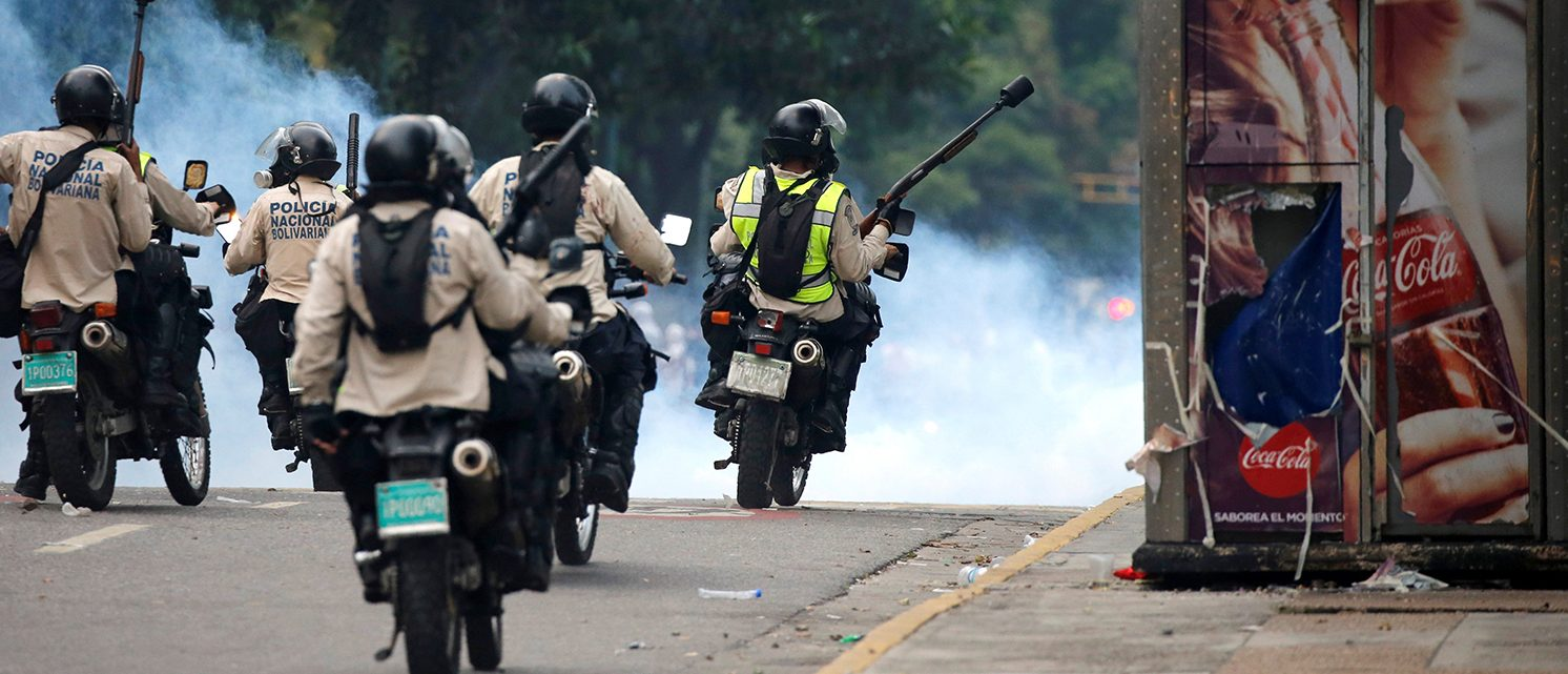 "Riot police take positions during the so called ""mother of all marches"" against Venezuela's President Nicolas Maduro in Caracas, Venezuela, April 19, 2017. (PHOTO: REUTERS/Carlos Garcia Rawlins)"