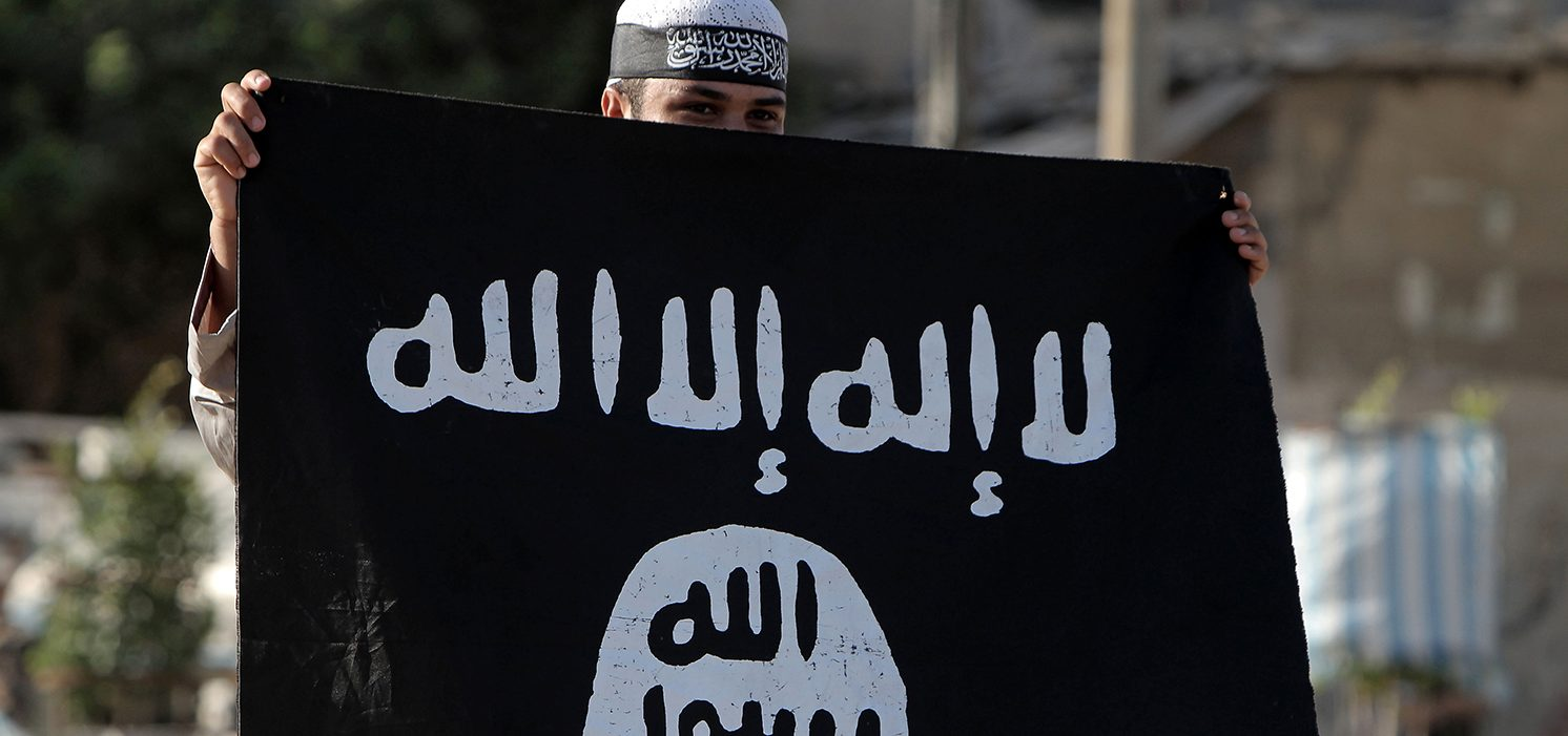 A Palestinian Salafist holds an Al-Qaeda-affiliated flag during a protest against an amateur film mocking Islam in Rafah in the southern Gaza Strip on September 14, 2012. Anti-US protests by crowds whipped into fury by a film that mocks Islam erupted across the Muslim world, as violence exploded in Sudan, Lebanon, Tunisia and Yemen leaving five dead and dozens injured. (PHOTO: AFP PHOTO/ SAID KHATIB)