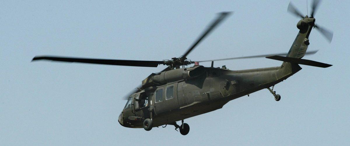 A US Army Black Hawk helicopter flies ov