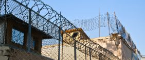 Prison with barbed wire. Sergey Mat/Shutterstock.