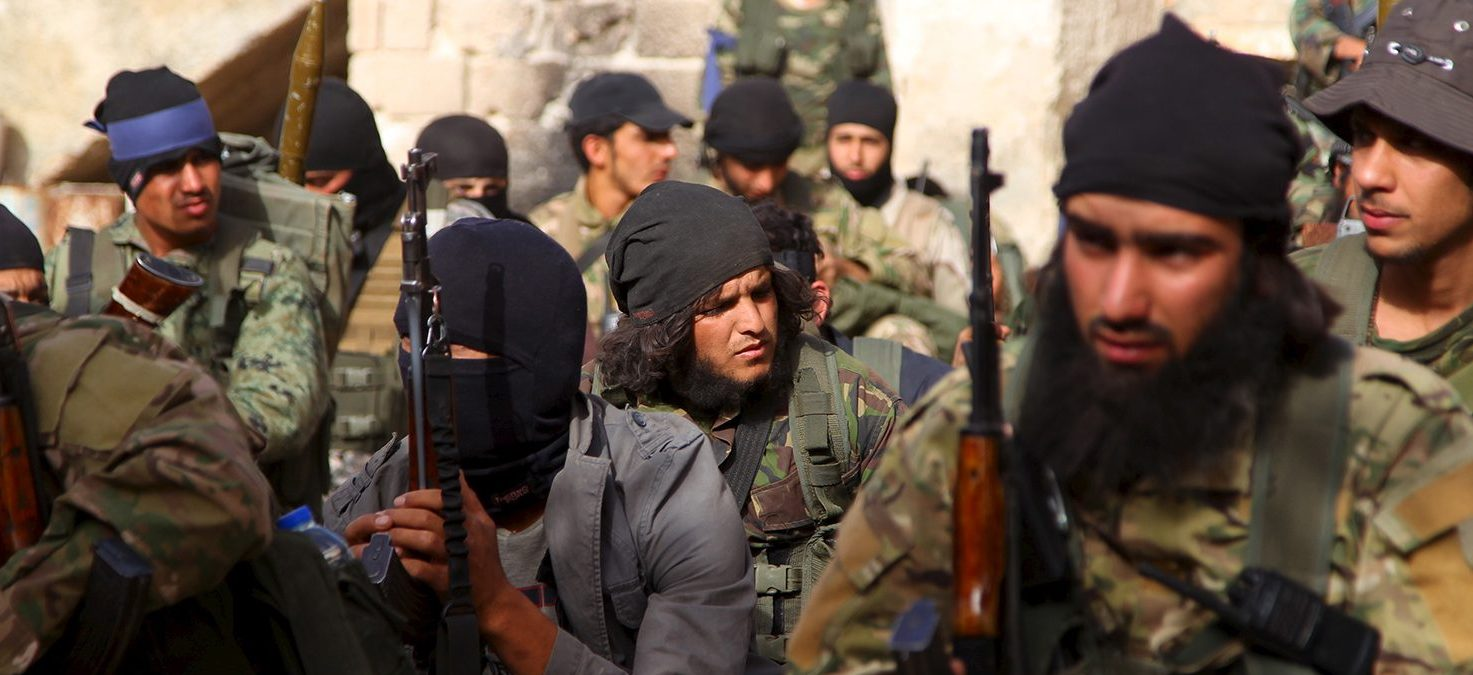 Members of al Qaeda's Nusra Front gather before moving towards their positions during an offensive to take control of the northwestern city of Ariha from forces loyal to Syria's President Bashar al-Assad, in Idlib province May 28, 2015. The Syrian army has pulled back from the northwestern city of Ariha after a coalition of insurgent groups seized the last city in Idlib province in northwestern Syria near the Turkish border that was still held by the government. (PHOTO: REUTERS/Ammar Abdullah)