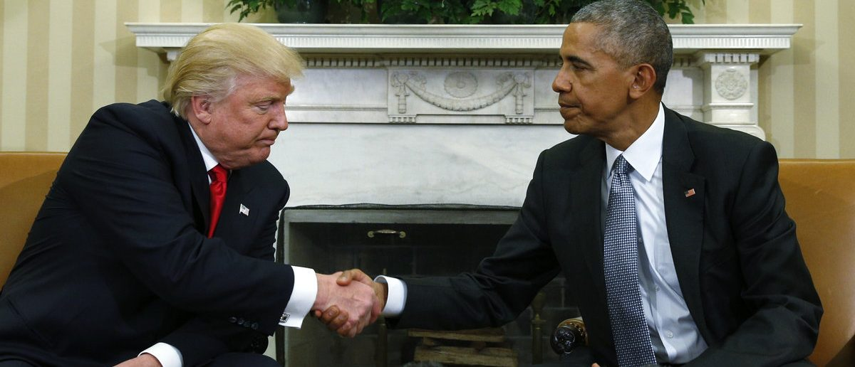 U.S. President Barack Obama (R) greets President-elect Donald Trump in the White House Oval Office in Washington, U.S., November 10, 2016. (REUTERS/Kevin Lamarque)