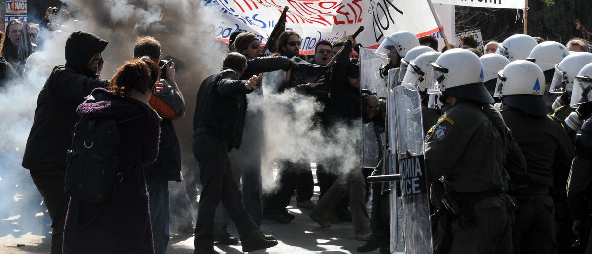 ATHENS, GREECE -FEB. 02: Violent clashes with use of tear gas, between the riot police and unemployed protesters in Athens Syntagma Square, February 07, 2010. (Shutterstock/Kostas Koutsaftikis)
