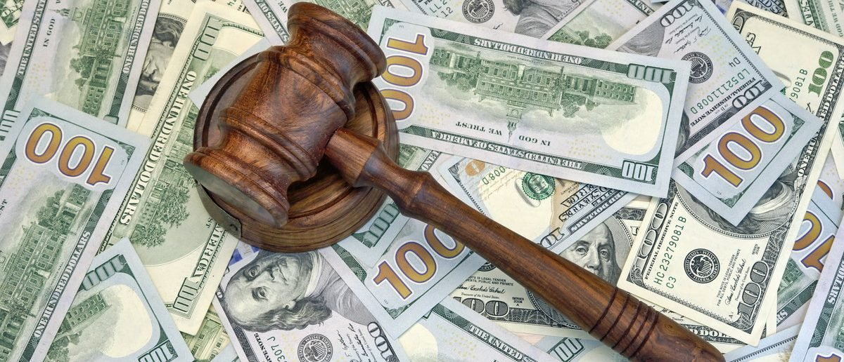 Judges Or Auctioneer Gavel On The Dollar Cash Background, Top View, Close-Up. Concept For Corruption, Bankruptcy, Bail, Crime, Bribing, Fraud, Auction Bidding, Fines  (Shutterstock/AVN Photo Lab)