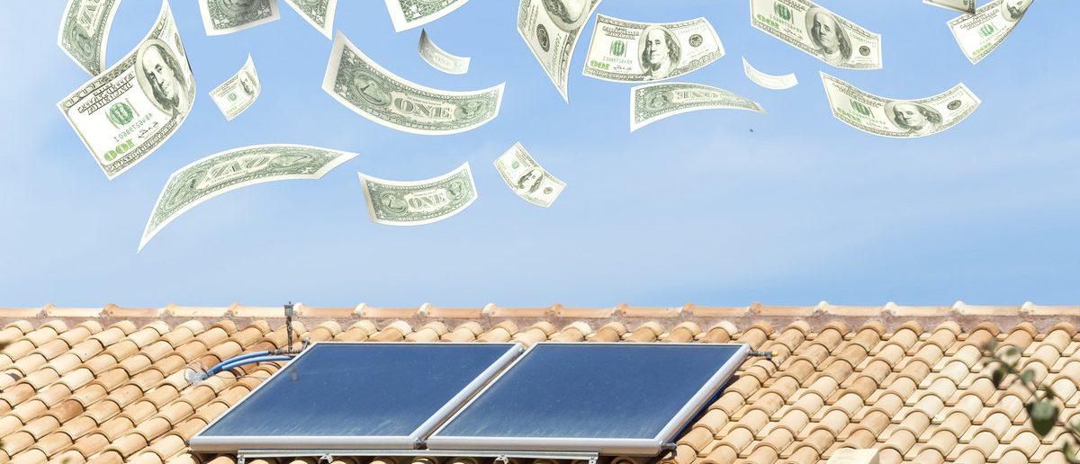 solar heater, money dollars flying from the sky, 3d rendering  (Shutterstock/ kostasgr )