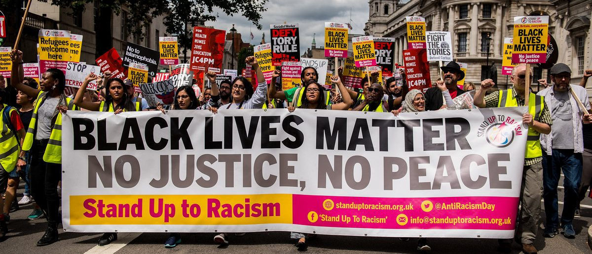 London, UK. 16th July 2016. EDITORIAL - Black Lives Matter / Stand Up To Racism protest rally - Thousands attended the march through London, in protest of recent killings of black men by U.S. police. (Shutterstock/ John Gomez )