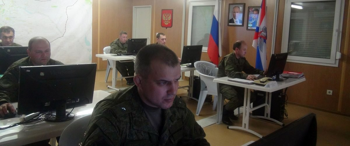Russian soldiers work behind their screens on March 17, 2016 in Russia's reconciliation center as they monitor the truce in Syria at the Hmeimim air base in the Latakia province. ? The truce, negotiated by Russia and the United States, began on February 27 and does not cover the fight against jihadist groups like Islamic State and the Al-Qaeda-affiliated Al-Nusra Front. STR/AFP/Getty Images.