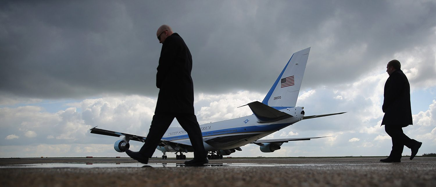 Secret Service personnel walk besides Air Force One as it taxis for take off for the departure of US President Barack Obama at Stansted Airport, on April 24, 2016 in London, England. Mr Obama is to visit Hanover in Germany to hold talks with German Chancellor Angela Merkel before returning to the US. (Photo by Dan Kitwood/Getty Images)