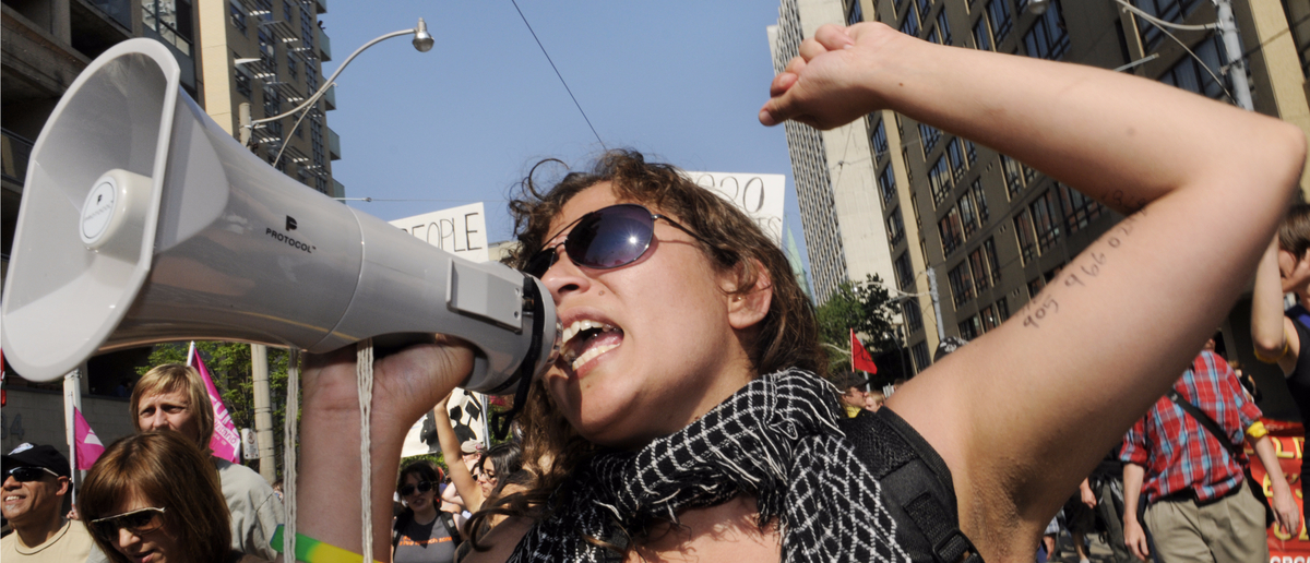 An angry protestor shouts into her megaphone (Photo: arindambanerjee/Shutterstock)