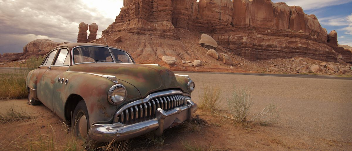 Desert Relic/Old Car rusting away in the desert. (Shutterstock/RollingFishays)