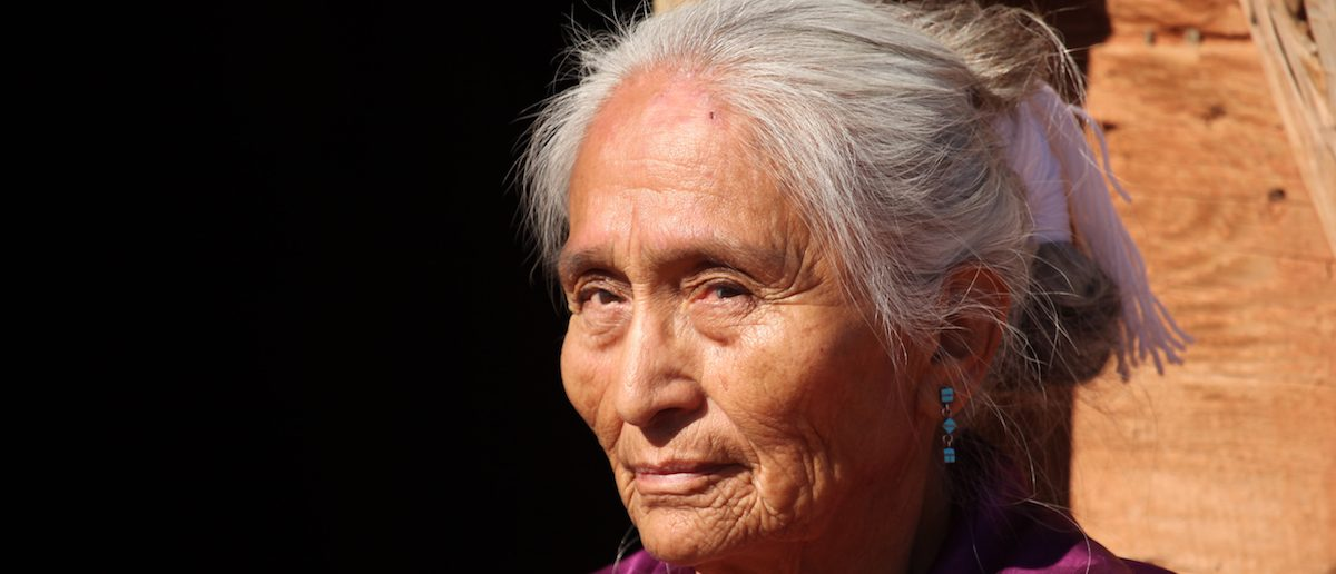 Navajo Elderly Woman Outdoors in Bright Sun (Shutterstock/tobkatrina)