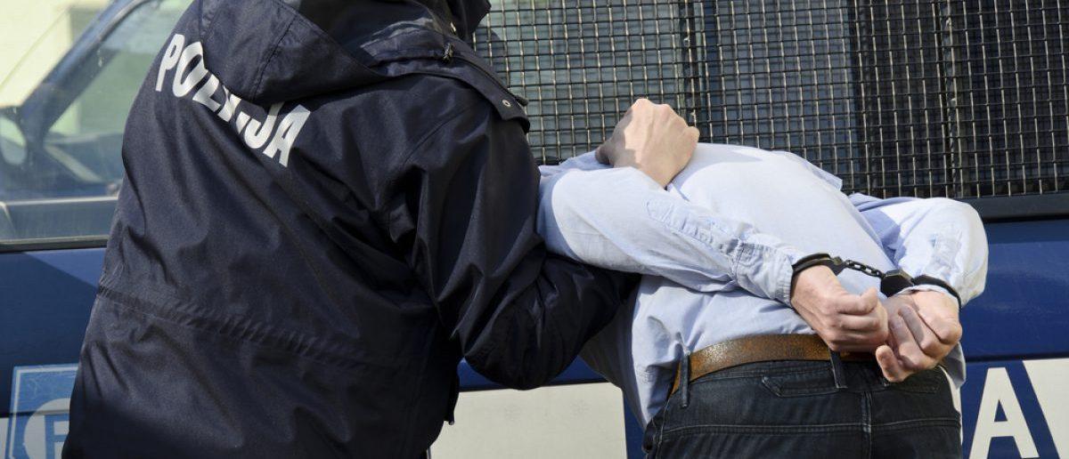 Police arresting a man. [Shutterstock - Monika Gruszewicz]