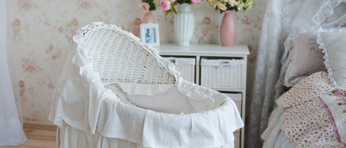 A baby's white crib. [Shutterstock - Vikkin]