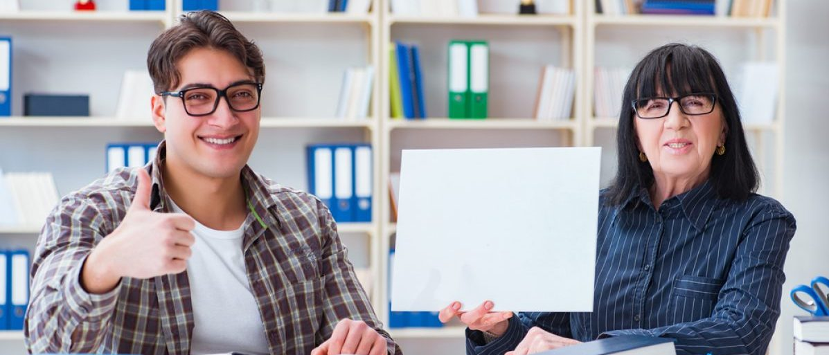 Smiling student and teacher (Shutterstock/Elnur)