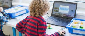 Boy using social media on his computer. [Shutterstock - Elena Sherengovskaya]