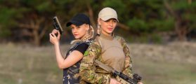 Women with firearms (Shutterstock/Olexandr Taranukhin)