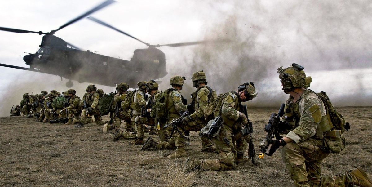 U.S. Army Rangers, assigned to 2nd Battalion 75th Ranger Regiment, prepare for extraction from their objective during Task Force Training on Fort Hunter Liggett, Calif., Jan. 30, 2014. Rangers constantly train to maintain their tactical proficiency. (U.S. Army photo by Spc. Steven Hitchcock)