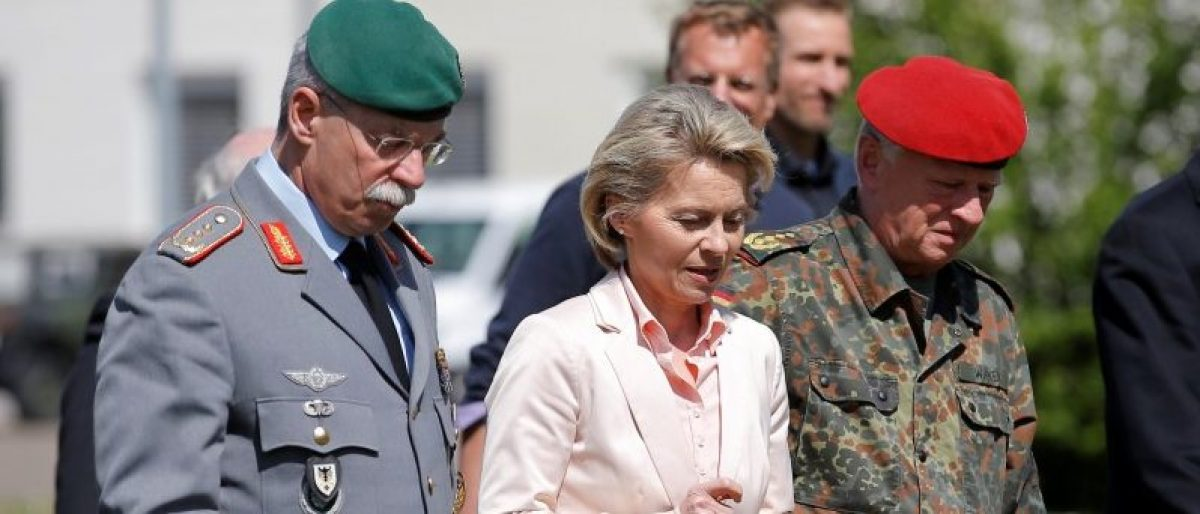 """German Defence Minister Ursula von der Leyen (C) walks with General Joerg Vollmer, General Inspector of the German Land Army (L), and General Volker Wieker, Inspector General of Germany's Armed Forces in Bundeswehr, during her visit at the 291st fighter squadron based at the """"Quartier Leclerc"""", a military facility for French and German military units in Illkirch-Graffenstaden near Strasbourg, France May 3, 2017. REUTERS/Vincent Kessler"""