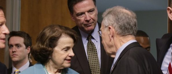 """FBI Director James Comey (C) is greeted by ranking member Sen. Dianne Feinstein (D-CA) (3rdL) and Committee Chairman Chuck Grassley (R-IA) (3rdR) as he arrives to testify before a Senate Judiciary Committee hearing on """"Oversight of the Federal Bureau of Investigation"""" on Capitol Hill in Washington, U.S., May 3, 2017. REUTERS/Kevin Lamarque"""