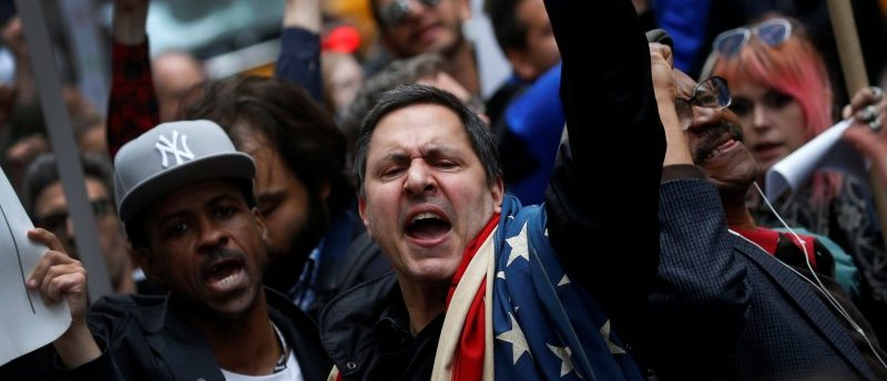 Protesters demonstrate near Trump Tower against U.S. President Donald Trump in the Manhattan borough of New York City, U.S. May 4, 2017. REUTERS/Mike Segar