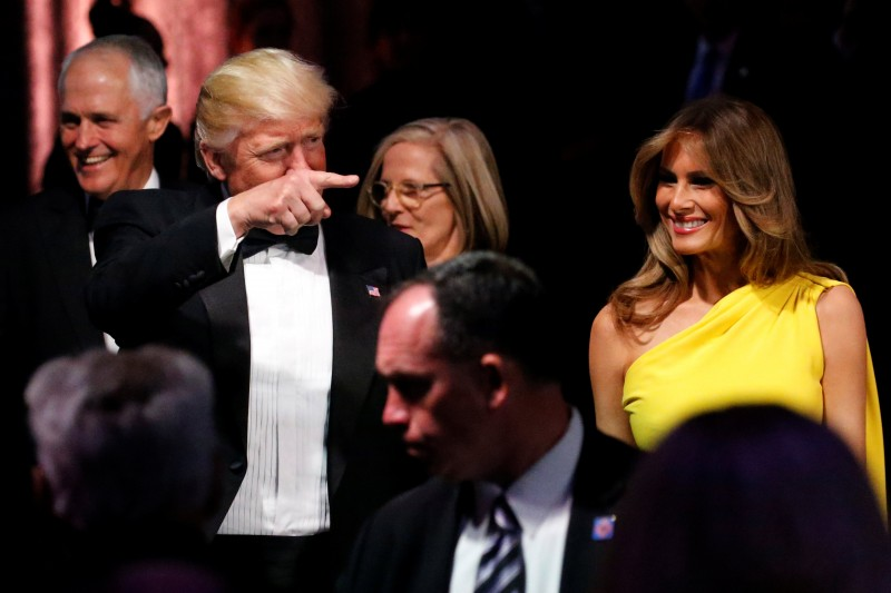 U.S. President Donald Trump (2nd L) and first lady Melania Trump (R) arrive with Australia's Prime Minister Malcolm Turnbull (L) and his wife Lucy Turnbull (C, back) at an event commemorating the 75th anniversary of the Battle of the Coral Sea, aboard the USS Intrepid Sea, Air and Space Museum in New York, U.S. May 4, 2017. REUTERS/Jonathan Ernst