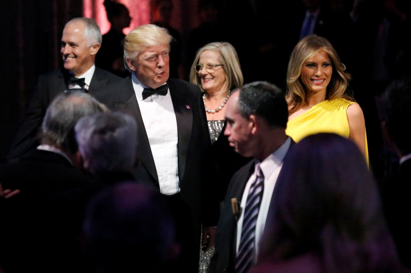 U.S. President Donald Trump (2nd R) and first lady Melania Trump (R) arrive with Australia's Prime Minister Malcolm Turnbull (L) and his wife Lucy Turnbull (C, back) at an event commemorating the 75th anniversary of the Battle of the Coral Sea, aboard the USS Intrepid Sea, Air and Space Museum in New York, U.S. May 4, 2017. REUTERS/Jonathan Ernst