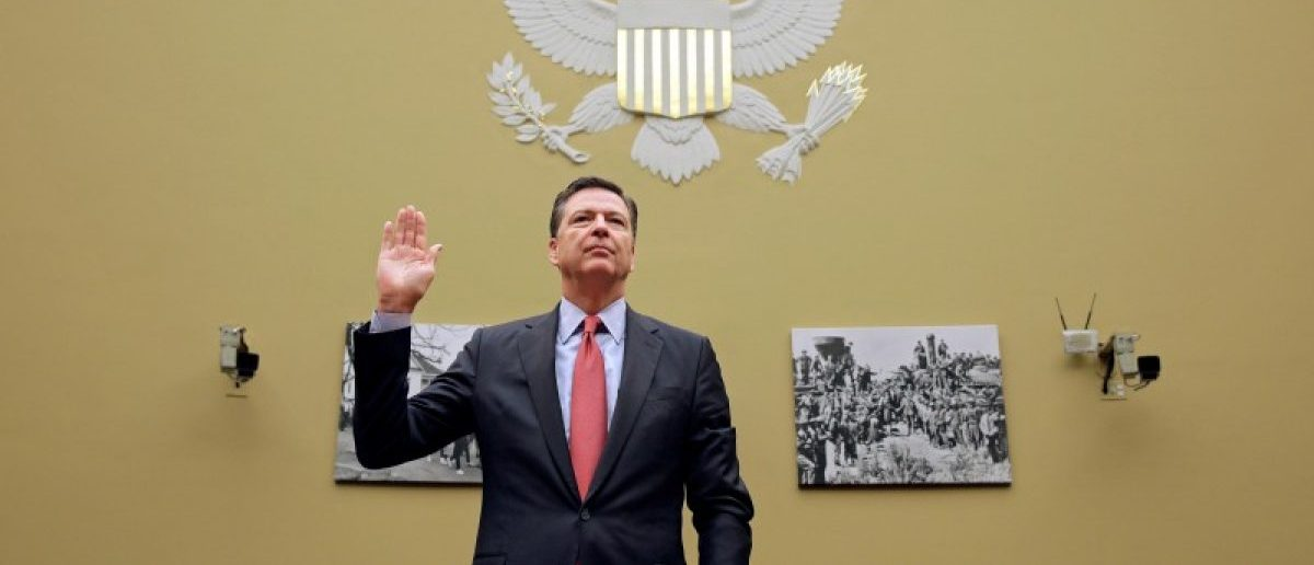 "FBI Director James Comey is sworn in before testifying before a House Judiciary Committee hearing on ""Oversight of the Federal Bureau of Investigation"" on Capitol Hill in Washington, U.S., September 28, 2016. REUTERS/Joshua Roberts/File Photo"