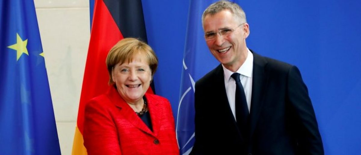 German Chancellor Angela Merkel and NATO Secretary-General Jens Stoltenberg shake hands after a news conference following their talks in Berlin, Germany, May 11, 2017. REUTERS/Fabrizio Bensch