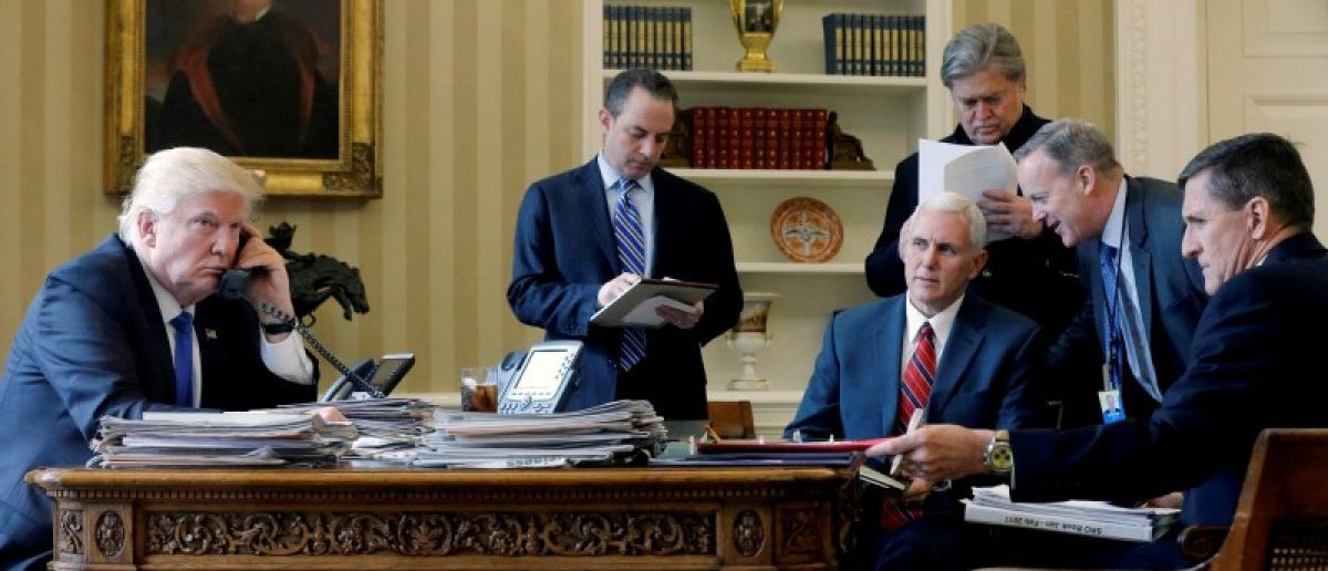 President Donald Trump (L-R), joined by Chief of Staff Reince Priebus, Vice President Mike Pence, senior advisor Steve Bannon, Communications Director Sean Spicer and then National Security Advisor Michael Flynn, speaks by phone with Russia's President Vladimir Putin in the Oval Office. REUTERS/Jonathan Ernst