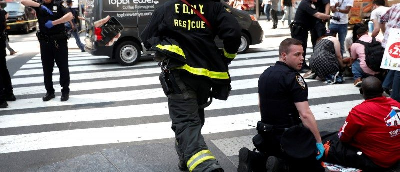 A New York City Fire Department (FDNY) emergency worker rushes to a scene in Times Square after a speeding vehicle struck pedestrians on the sidewalk in New York City, U.S., May 18, 2017. REUTERS/Mike Segar