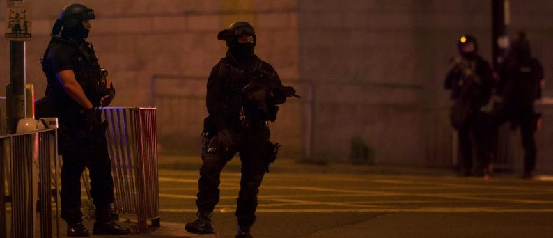 Armed police officers stand outside the Manchester Arena, where U.S. singer Ariana Grande had been performing in Manchester, northern England, Britain May 22, 2017. REUTERS/Jon Super