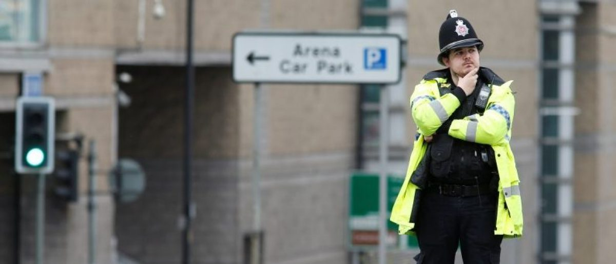 A police officer stands near the cordon around the Manchester Arena, Britain May 23, 2017. REUTERS/Andrew Yates