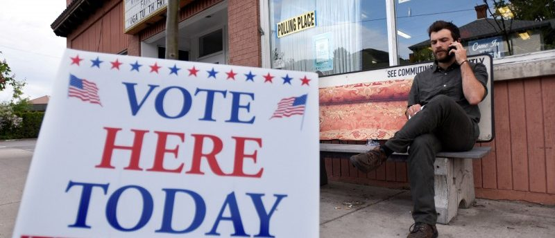 Matteo Bjornsson sits outside a polling center during a special congressional election called after former Rep. Ryan Zinke was appointed to lead the Interior Department in Missoula, Montana May 25, 2017.   REUTERS/Tommy Martino