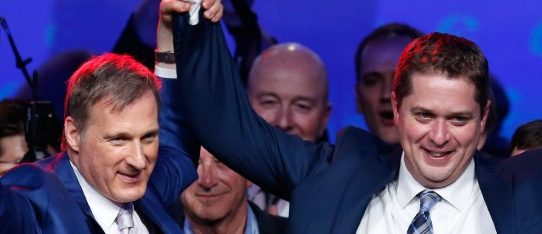 Maxime Bernier (L) celebrates with Andrew Scheer  after Scheer's leadership win during the Conservative Party of Canada leadership convention in Toronto, Ontario, Canada May 27, 2017. REUTERS/Chris Wattie
