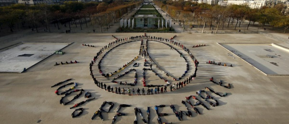 FILE PHOTO: Hundreds of environmentalists arrange their bodies to form a message of hope and peace in front of the Eiffel Tower in Paris, France, December 6, 2015, as the World Climate Change Conference 2015 (COP21) continues at Le Bourget near the French capital.