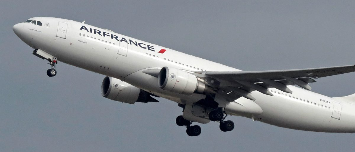 An Air France Airbus A330 airplane takes off past a control tower at the Charles-de-Gaulle airport in Roissy during an air traffic controller strike, near Paris, France, March 7, 2017. REUTERS/Christian Hartmann